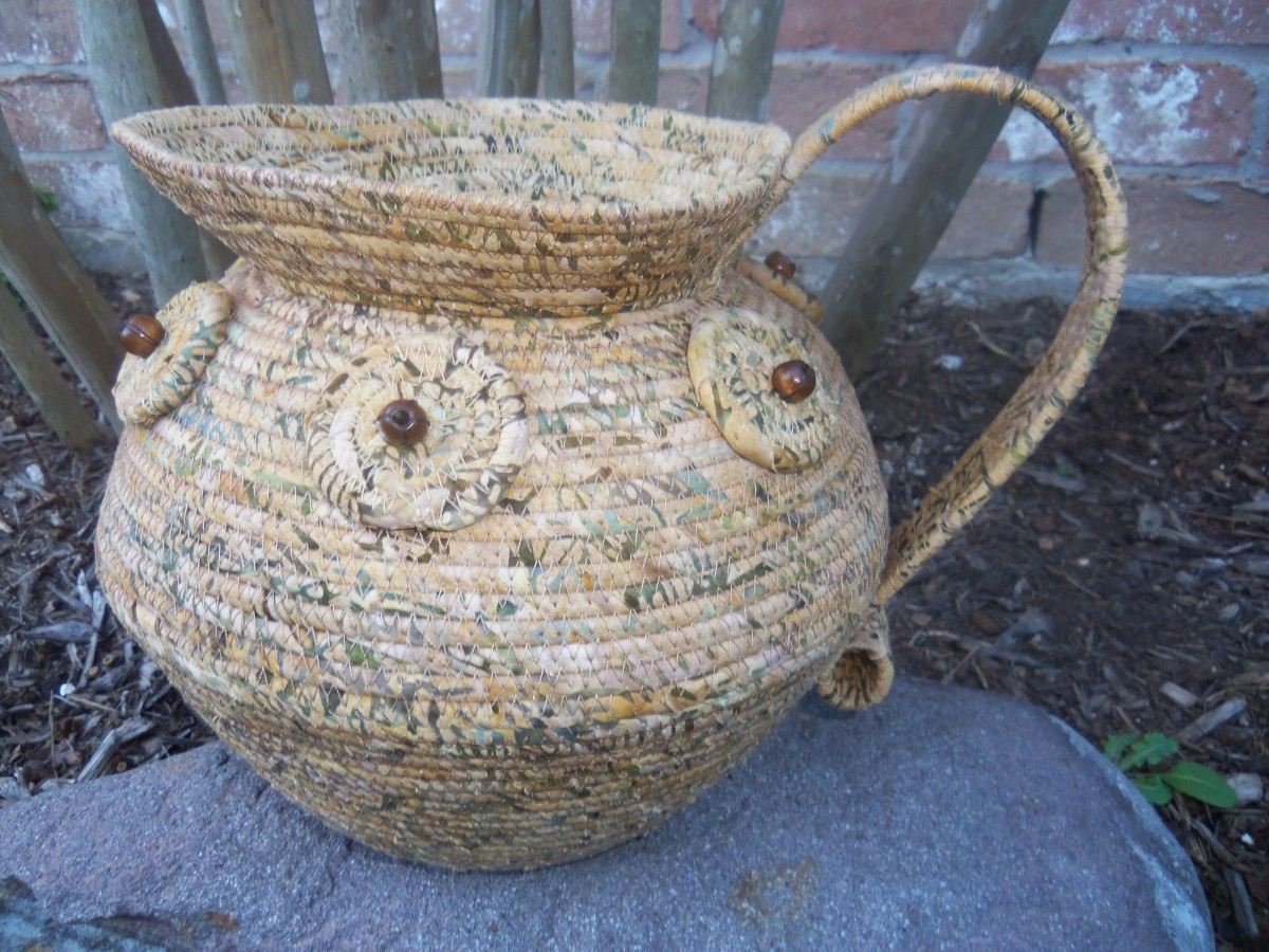 Fabric-wrapped cording pitcher made by Sherrill Andrea.