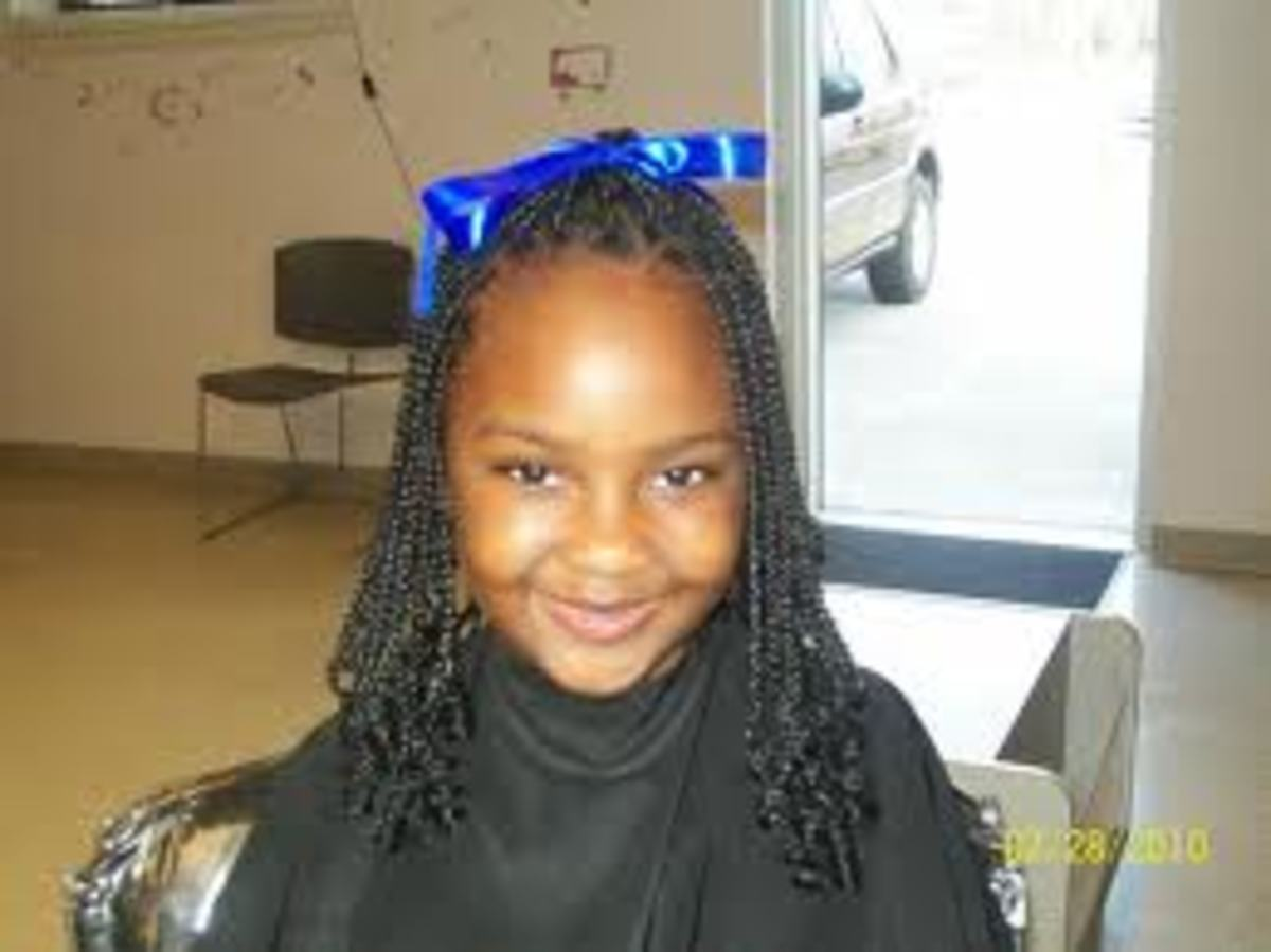This is box braids simply tied back. It lets the child  play without entering the eyes