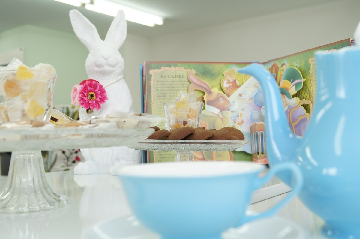 Place a whit bunny rabbit or a story book on each table for the centerpiece.