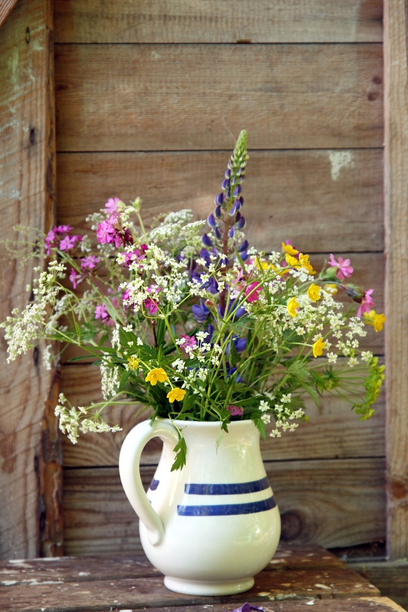 2. Fill jugs up with flower and place them around the room.