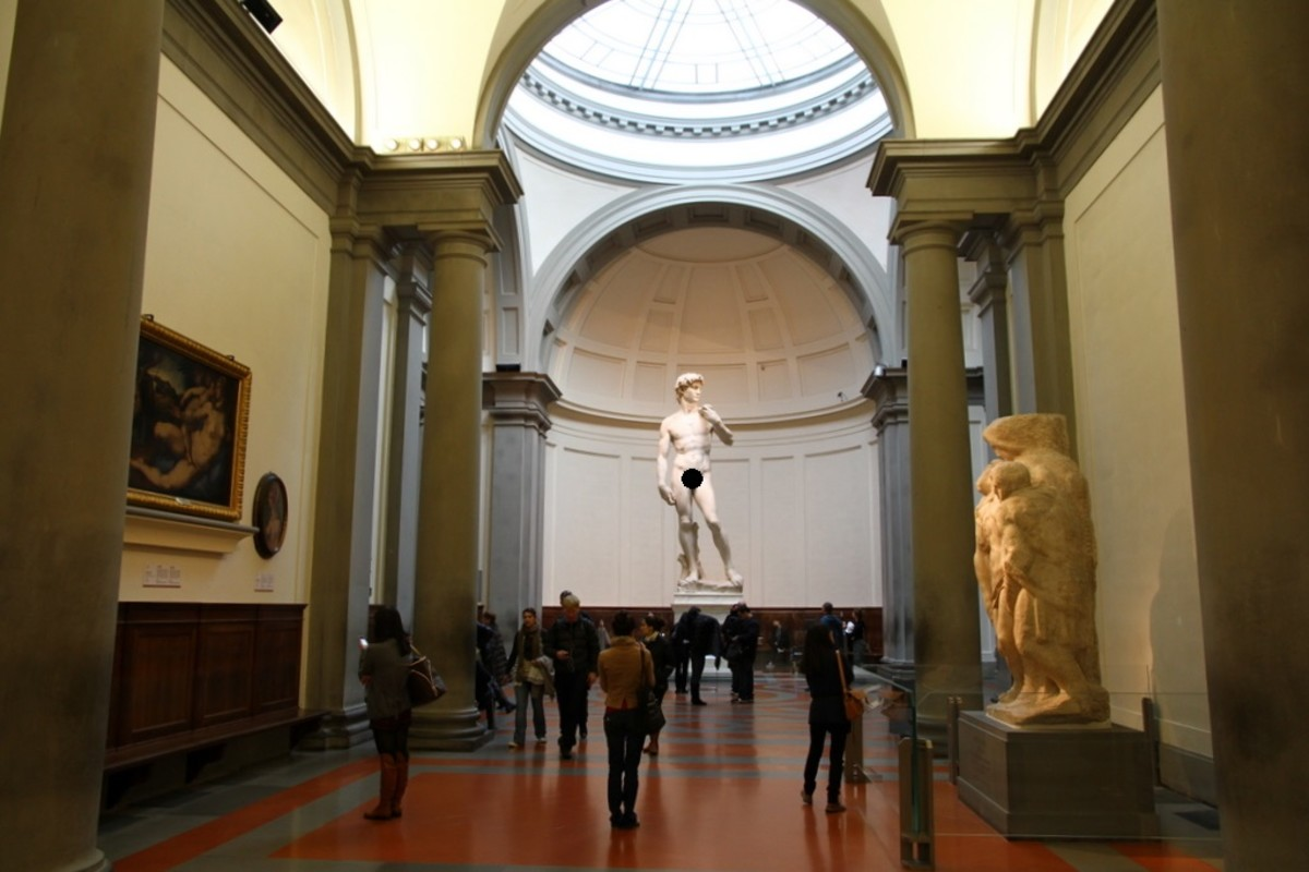 Interior of Accademia Galleria with David in the center.