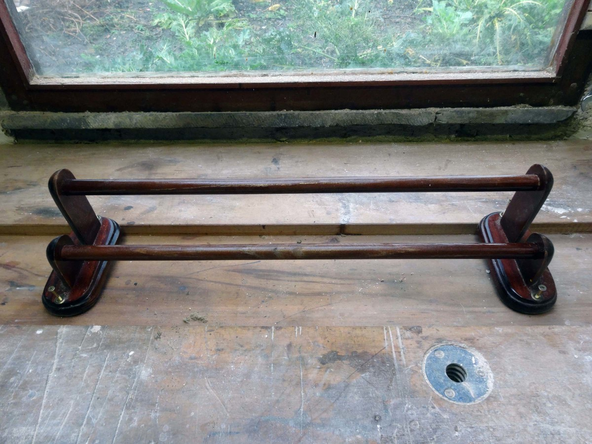 Original towel rail to be repurposed into toilet roll holder.