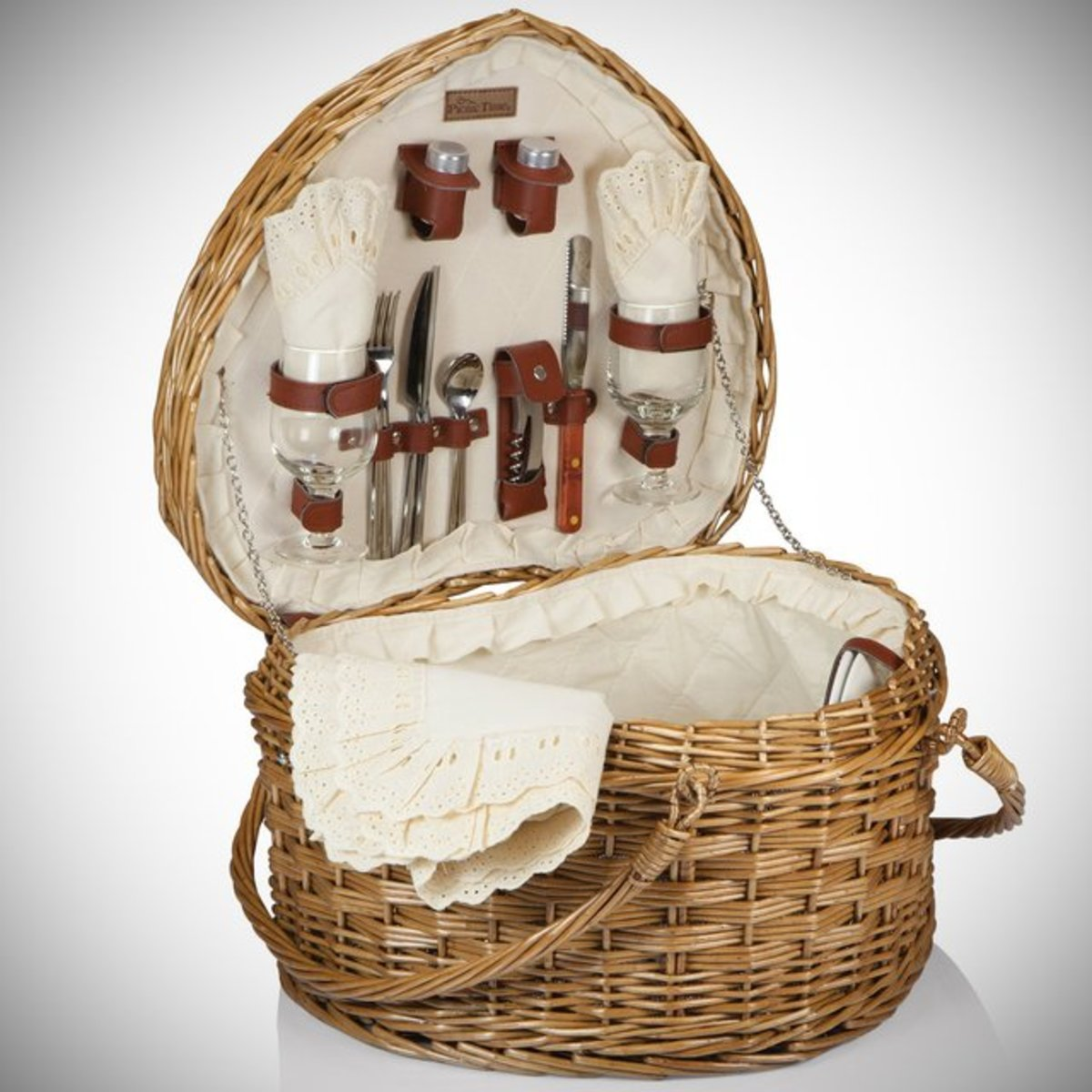 Choose a basket that is either heart-shaped or which is adorned with hearts. This picnic basket will do the trick, because heart-shaped baskets are quite difficult to find. The silverware and glasses could be cleared out to leave the base.