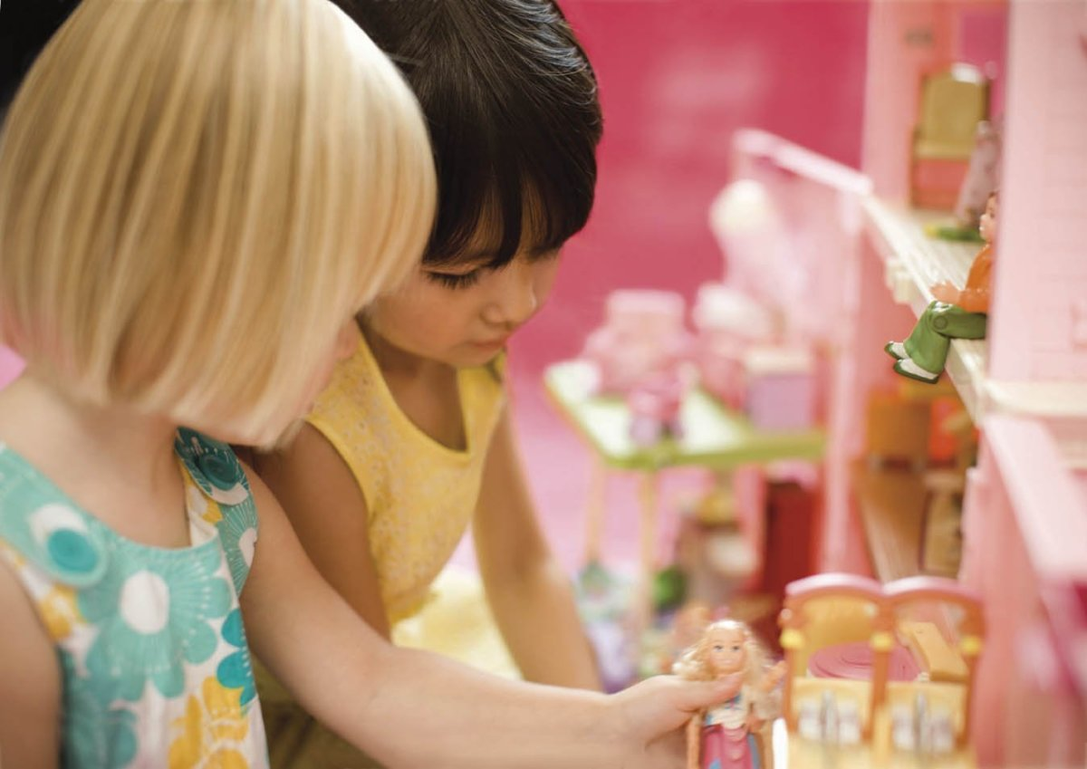 Children play with the Loving Family Grand Dollhouse.