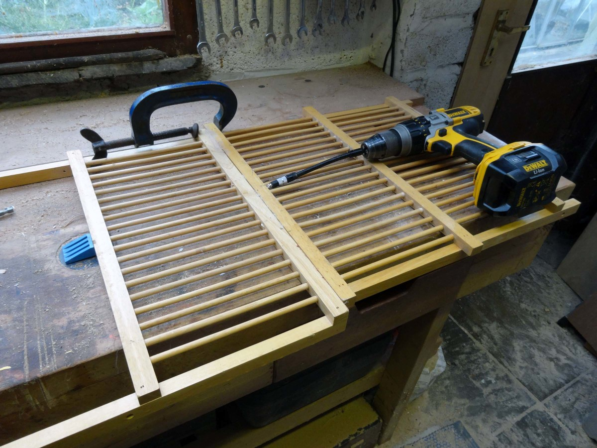 Gluing and screwing the old dish rack panels together to make the shoe rack.