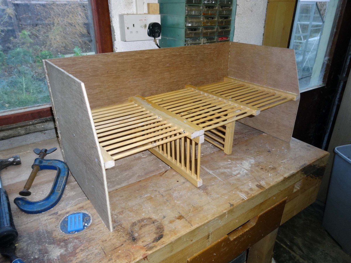 Adding the plywood sides to the bespoke shoe rack.