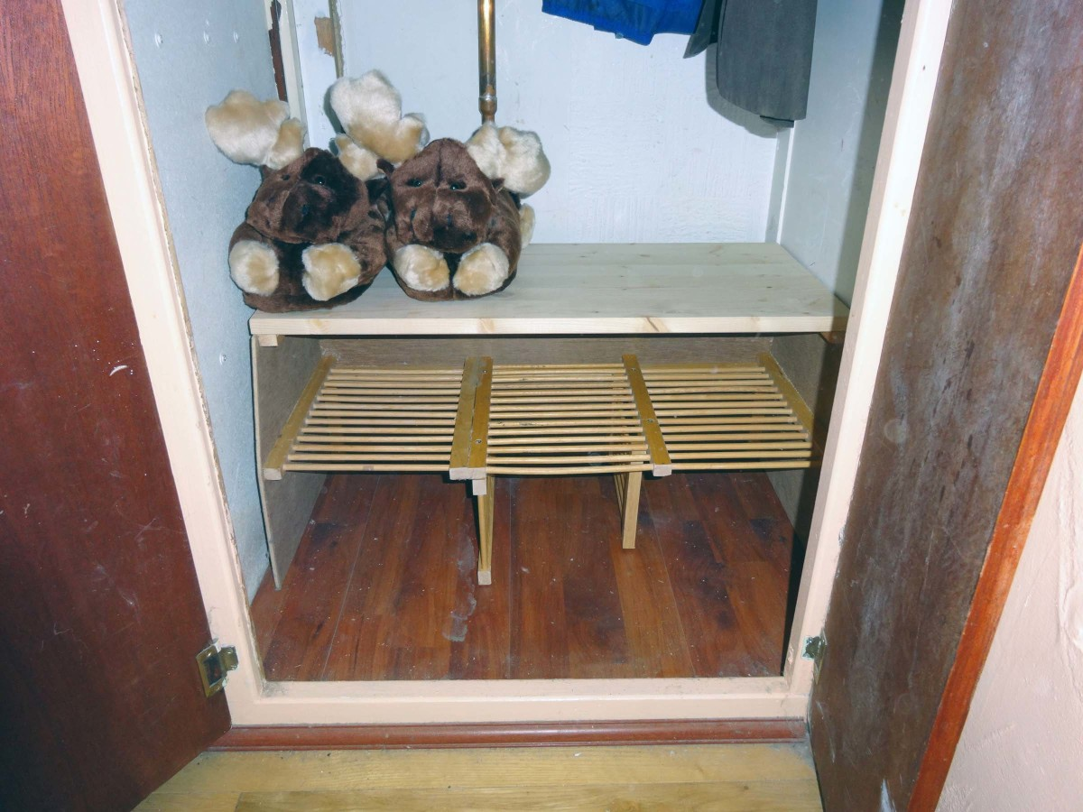 Fitting new bespoke shoe rack, upcycled from old dish rack, into built-in wardrobe.