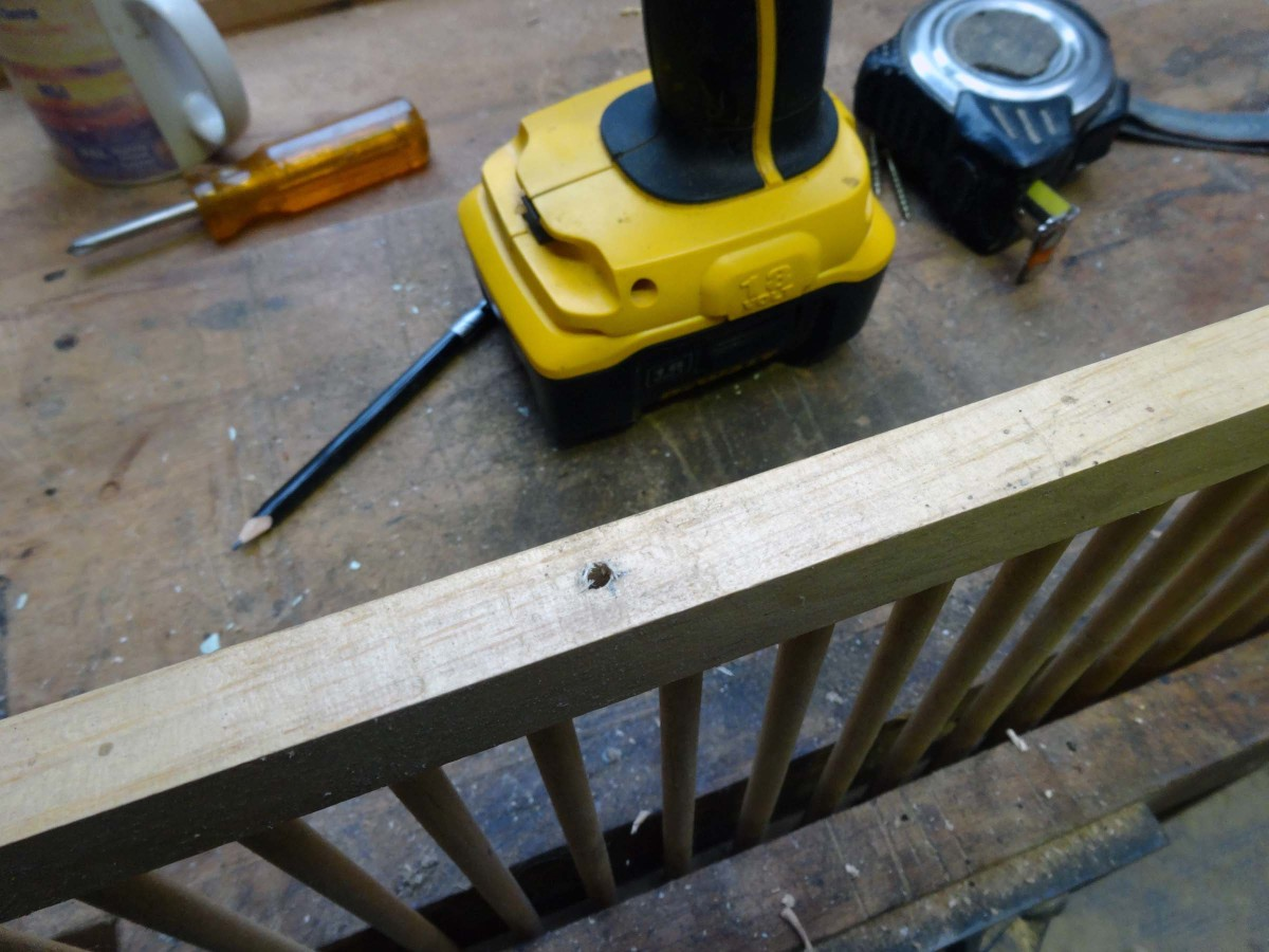Drilling pilot holes for re-joining the dish rack rails to make the shoe rack.