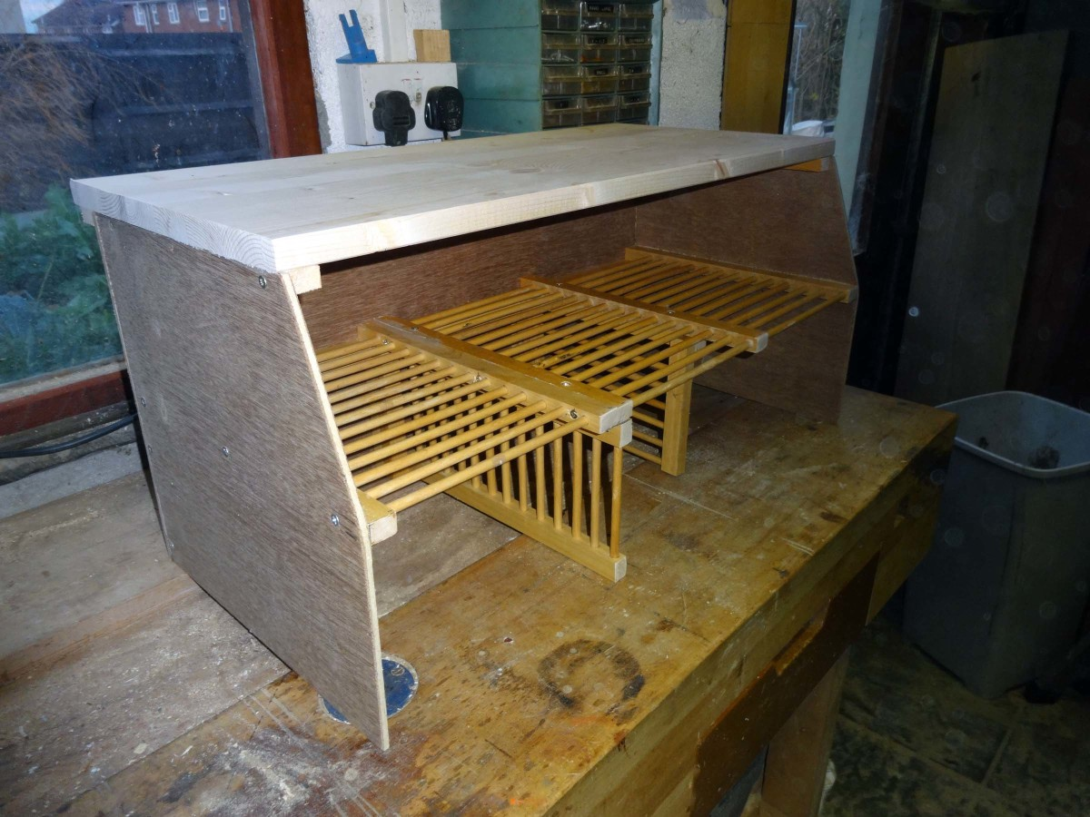 Adding the pine panel as the top shelf to the shoe rack.