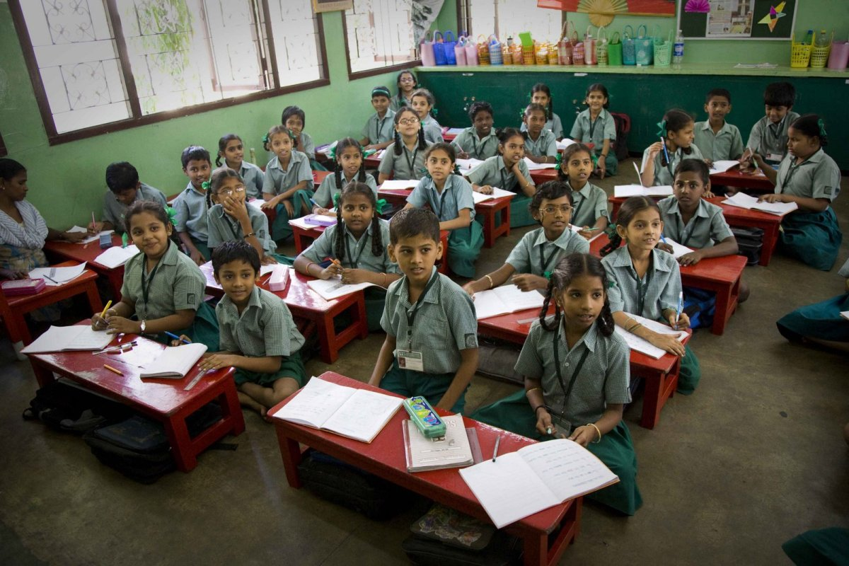 Students in India studying in the traditional education system