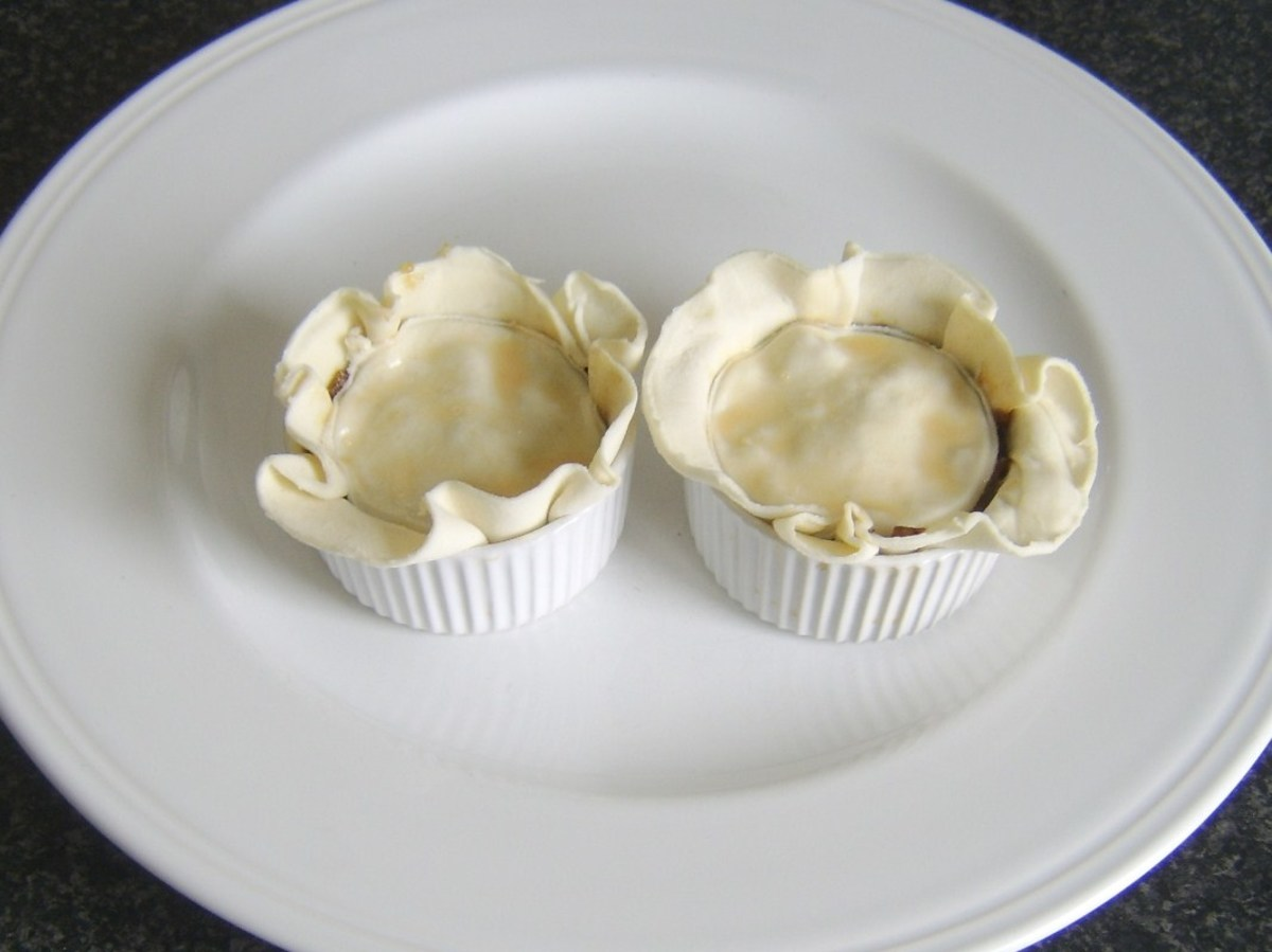 Puff pastry lids are added to the mincemeat pies
