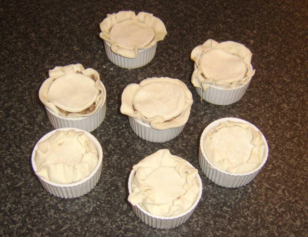 Lids are fitted to mini puff pastry pies