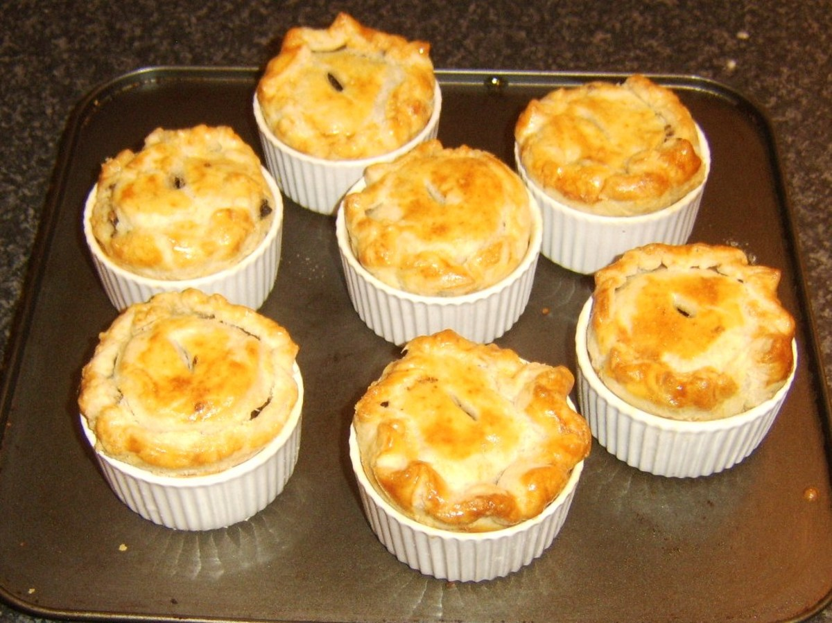 Mini haggis and clapshot puff pastry pies removed from oven