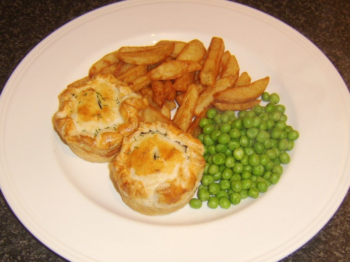 Mini haggis and clapshot puff pastry pies with homemade chips and peas