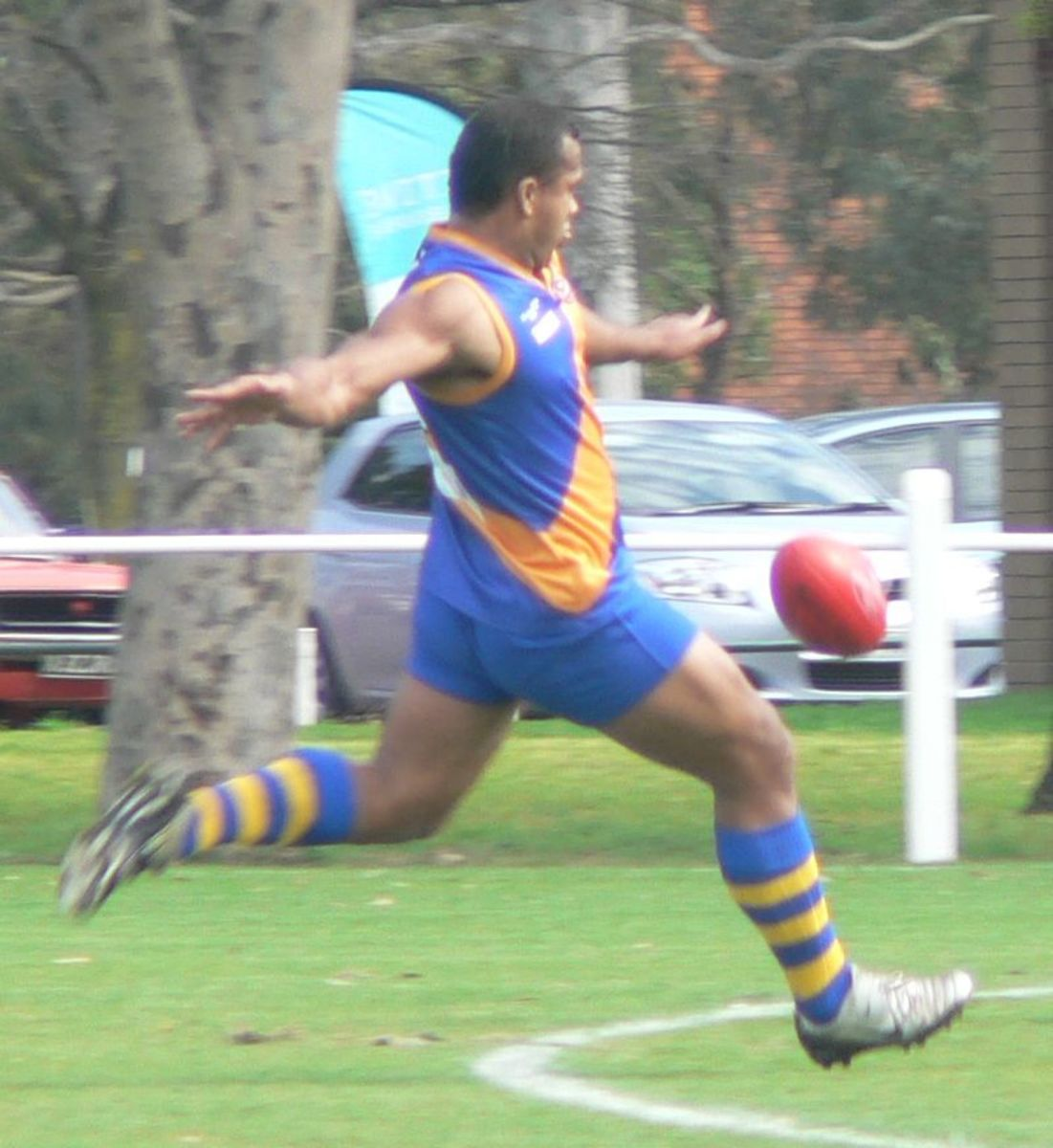 Man kicking a ball.