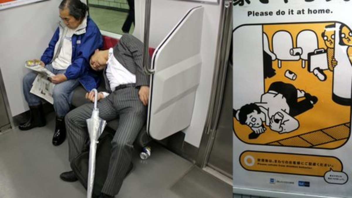 Commuter etiquette poster in Tokyo Subway on sleeping in the train & photo of someone sleeping off the shoulder of stranger. Reasons: long commute time, an hour, two hours. They also stay out late drinking, but have to be up early for work