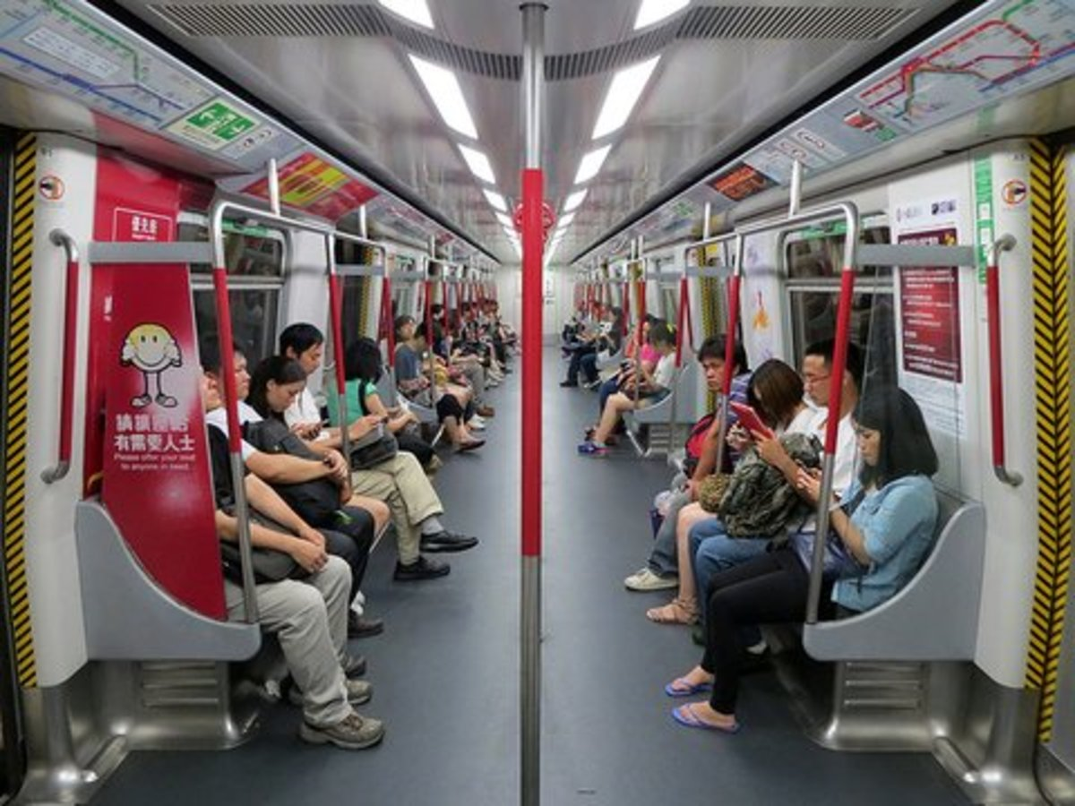 Hong Kong Metro is equipped with free 4G WiFi and everyone is busy on their hand phone or laptop