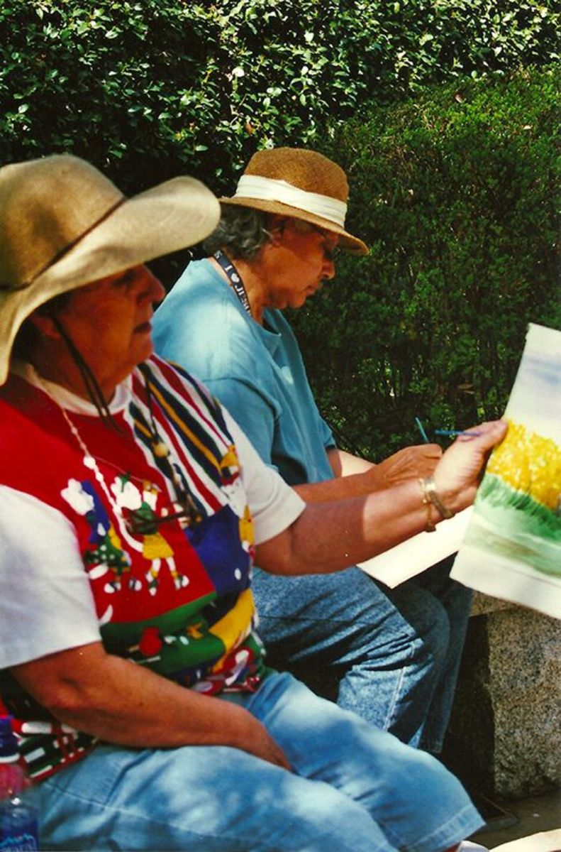 Lupe and Carleen painting in the park.