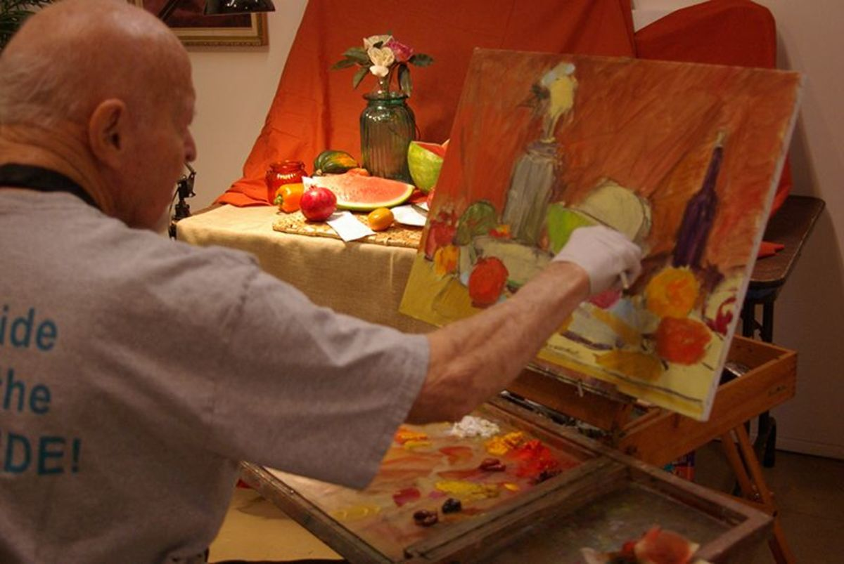 Dean Dallin painting a still life.