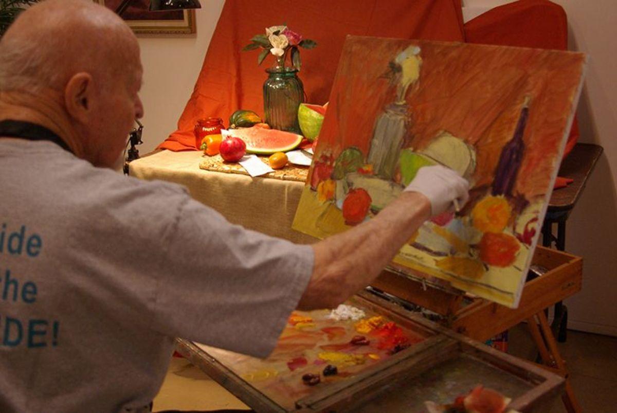 Dean Dallin painting a still life.