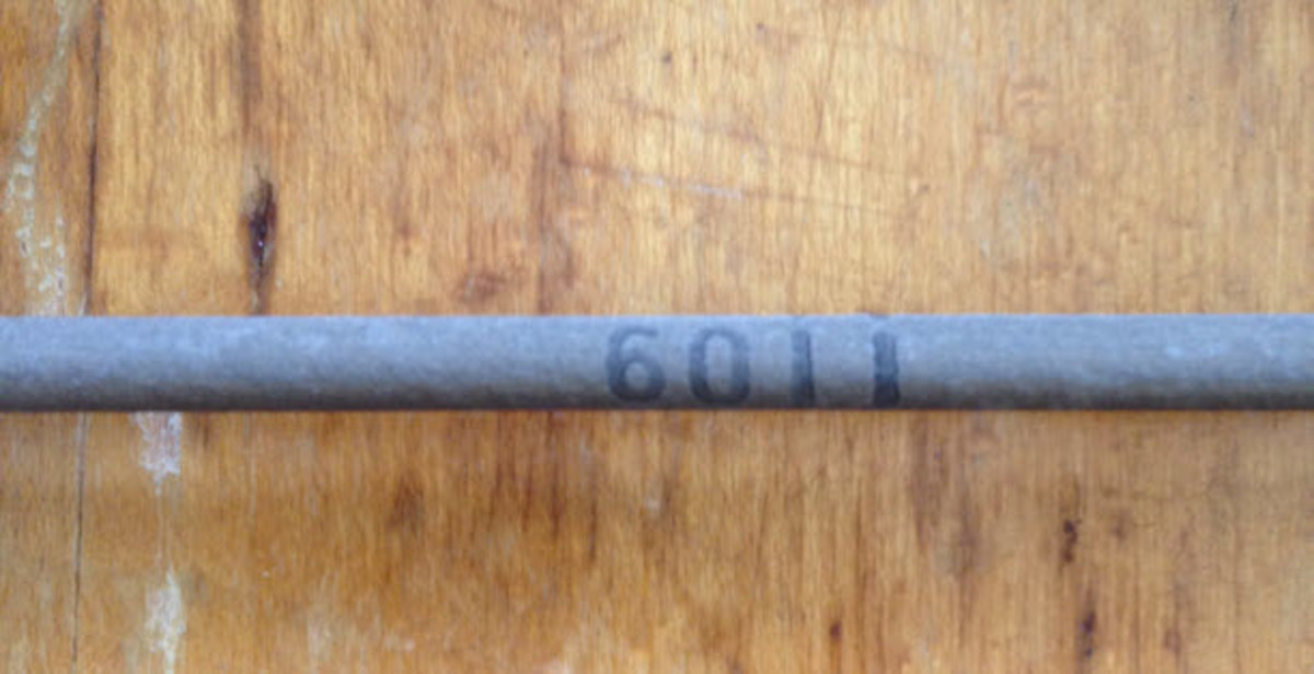 Lincoln E6011 Welding Rod Stamp.
