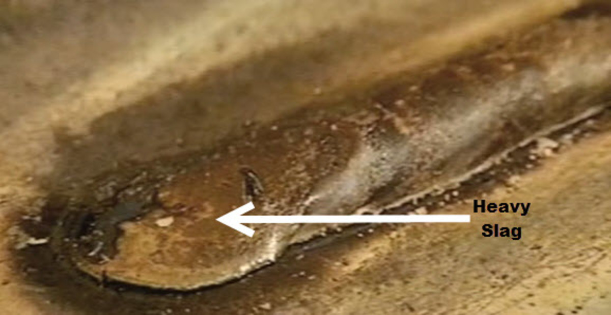 Example of a heavy slag coating over the weld using E7018.