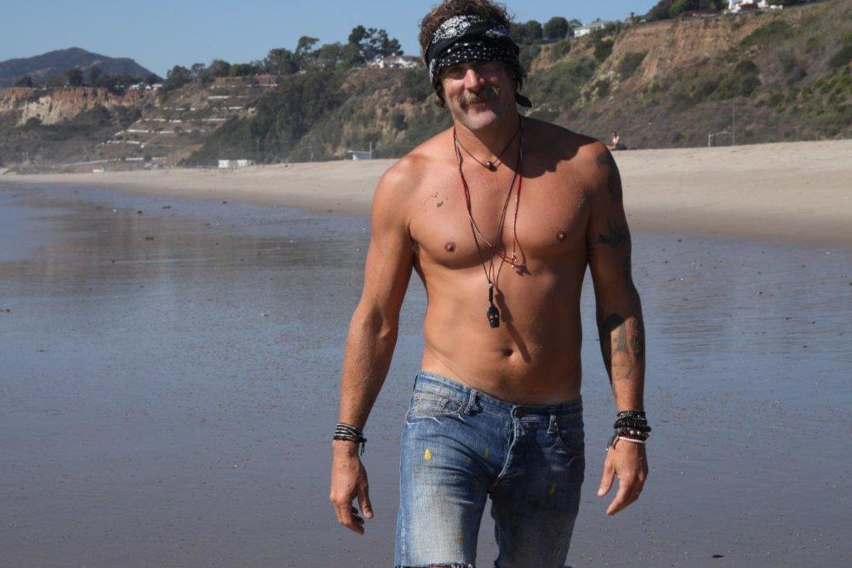 Donavon Frankenreiter is a professional surfer, musician, and a personal friend of Chan Luu. Here is in on a beach wearing Chan Luu bracelets