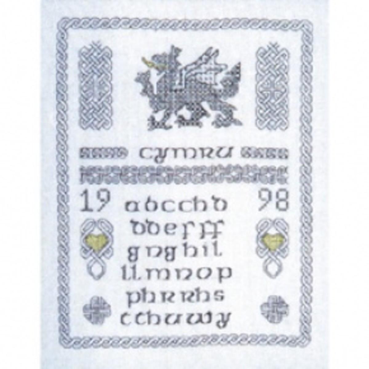 Ornate sampler depicting the Welsh dragon and masses of Celtic knots.  With Welsh alphabet.
