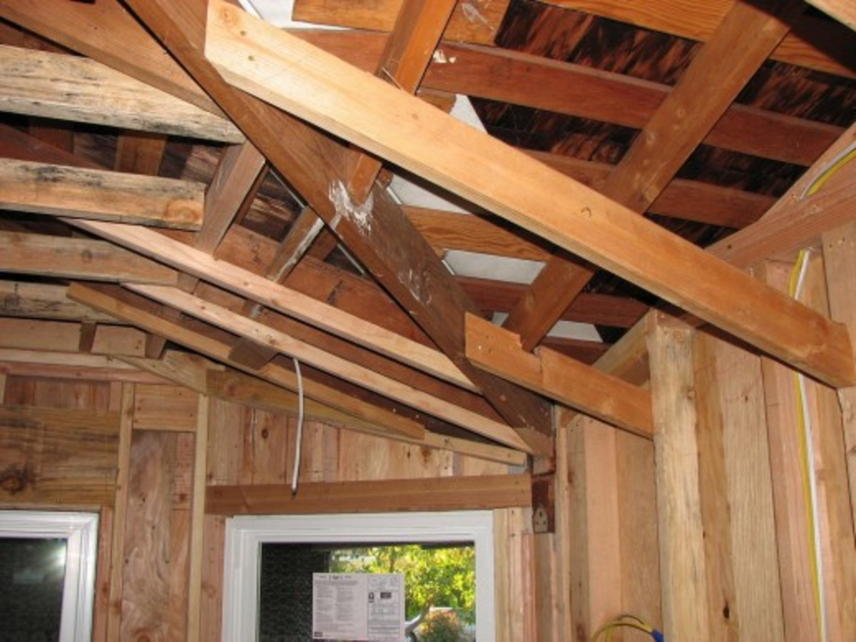 The roof of the house is tied straight to the timber frame; this type of roof may also need some steel rods that start from the concrete floor to tie down the roof frame down, this depends on the construction and the by laws of the local government
