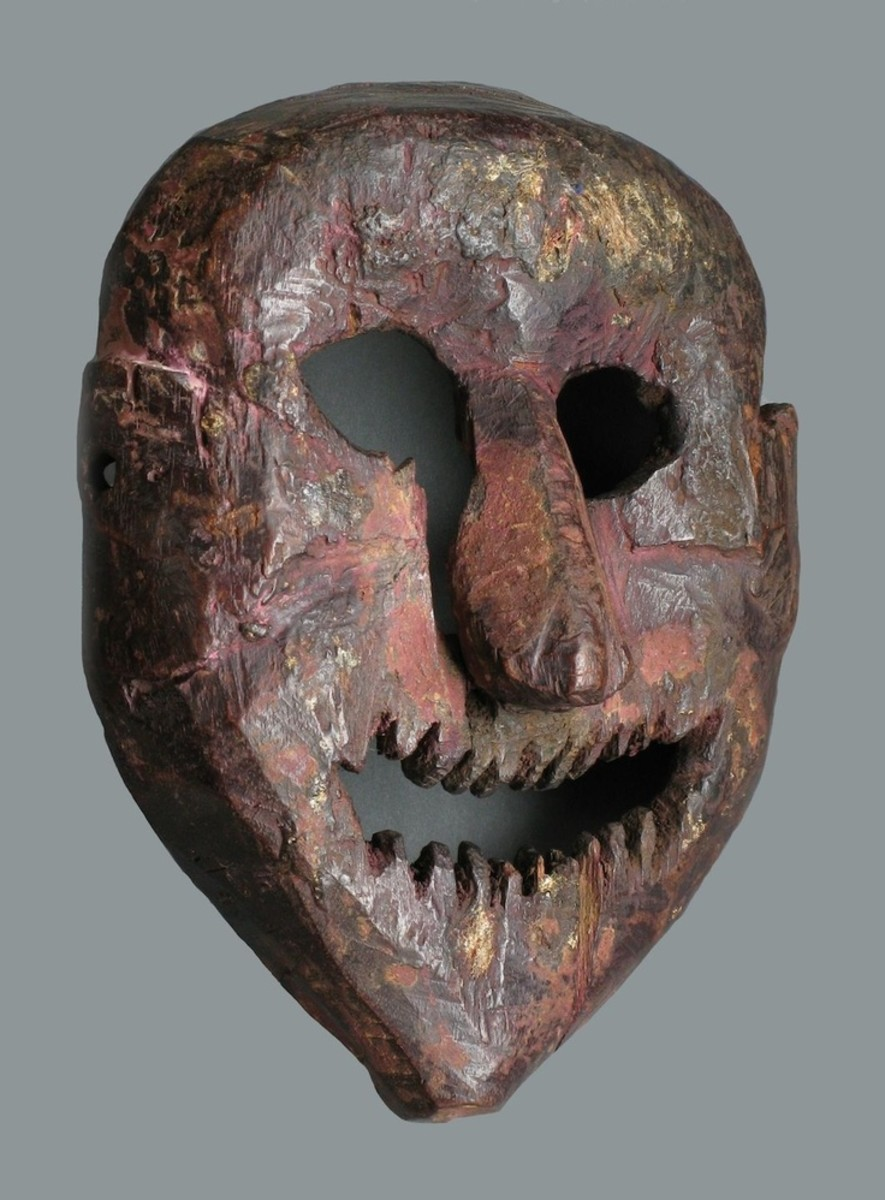 "Himalayan Mask  Wood with pigments and wear 8 1/4"" high x 6 1/2"" wide Early 20th century"