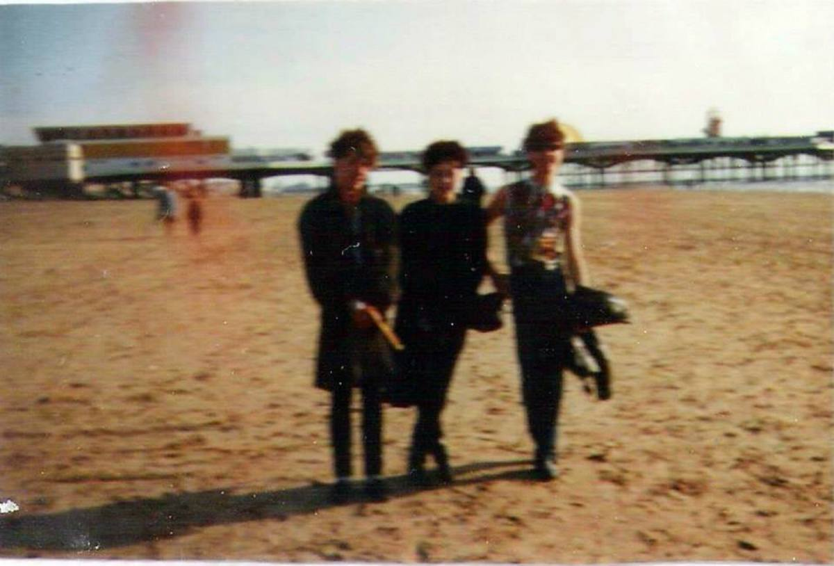 From left: Kevin, me and Peter walking on Blackpool beach in the summer (1984)