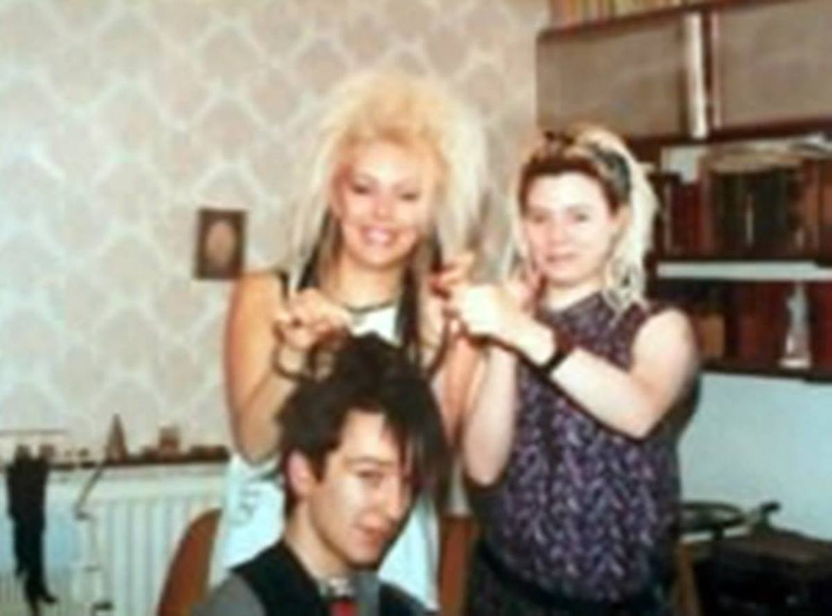 This was me and Michelle doing hair extensions for John (Elvis) in the mid-1980s in my parents' dining room