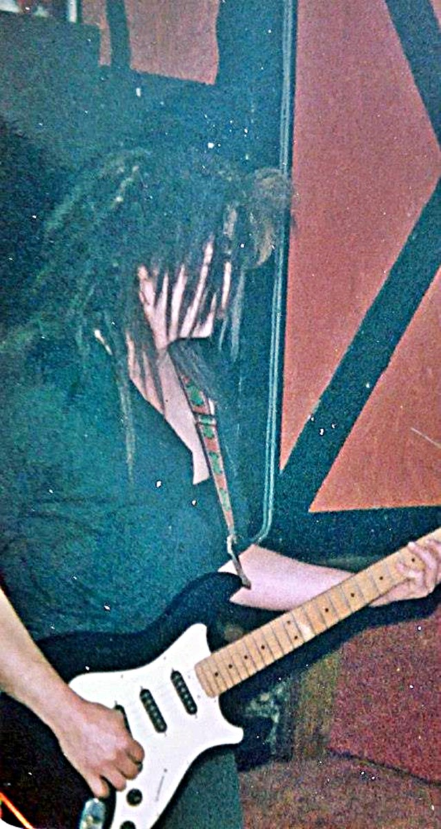 My friend Steve, playing in a band, with his hair extensions