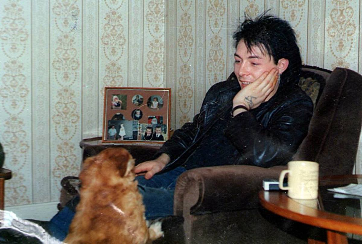 My dog, Susie, trying to get on Andy's knee (1987) at my house after we had been clubbing.