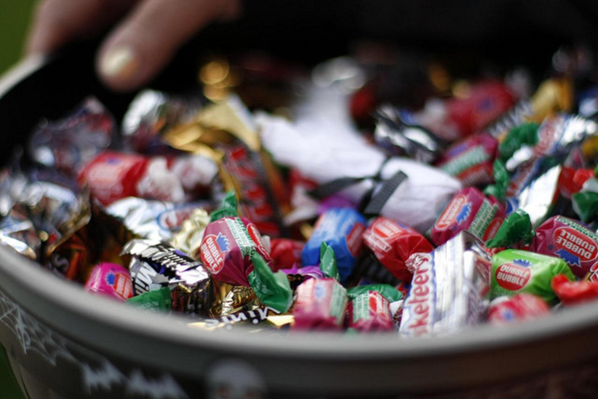 Children collect candy in the modern American trick or treat.