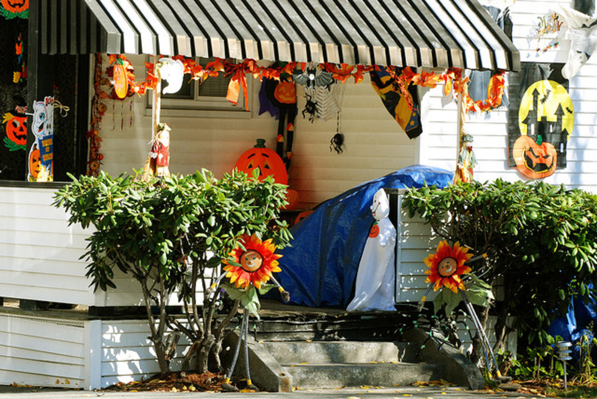 Many people decorate their porches for Halloween to invite children to come trick or treating.