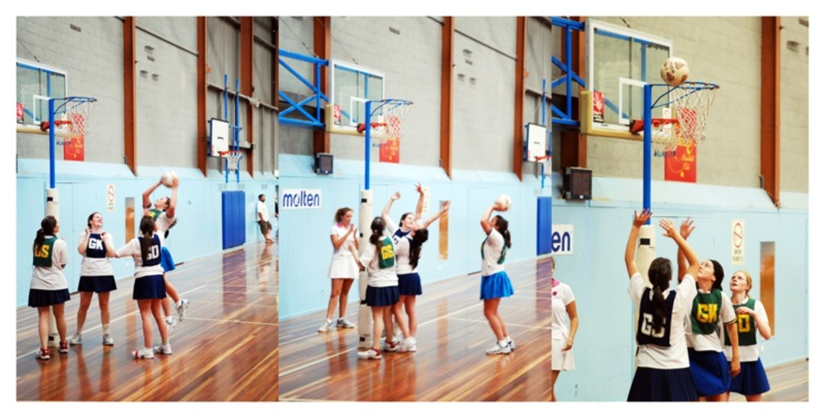 Netball players performing shooting drills