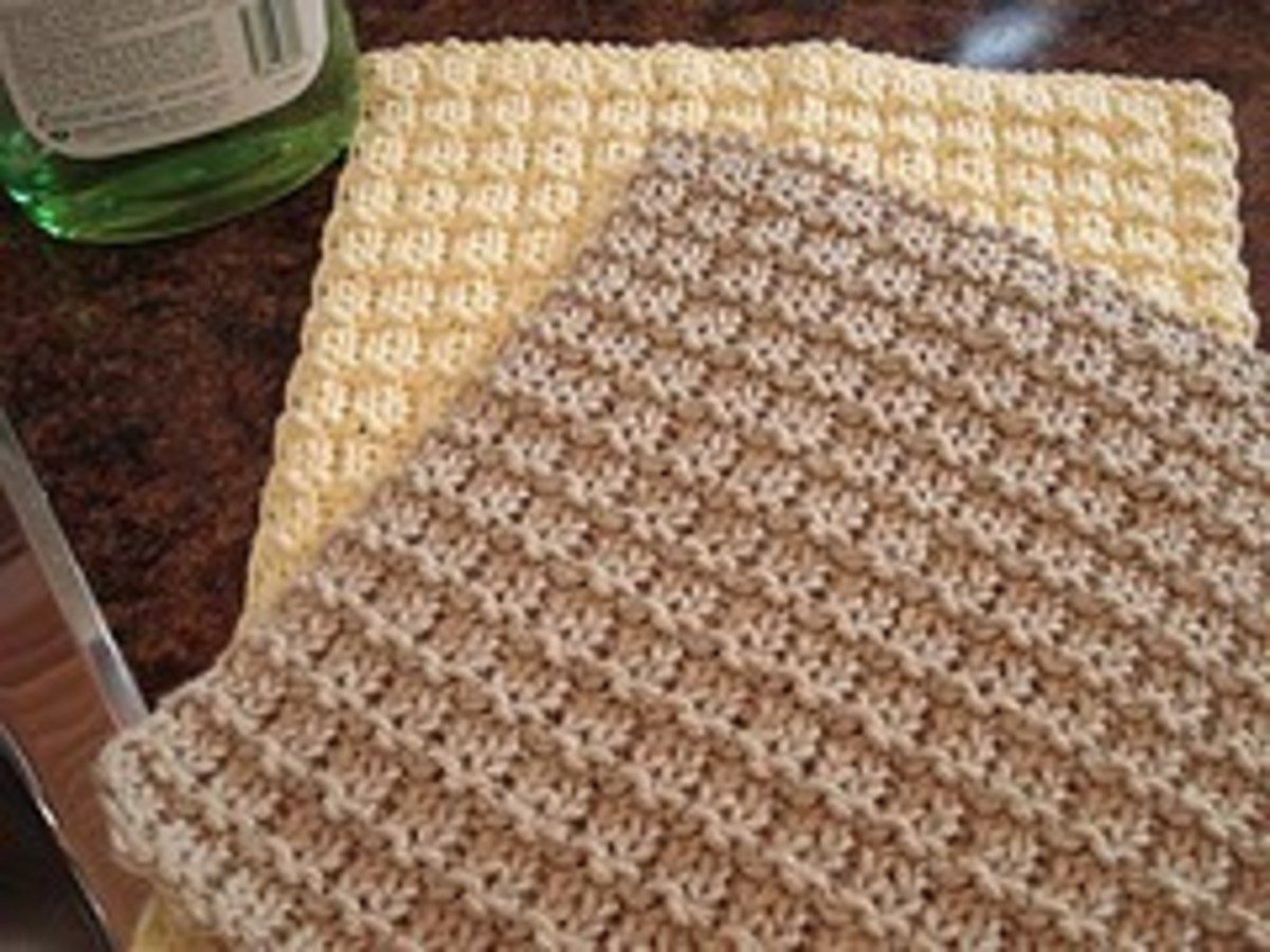 Fun to knit textured dishcloth using worsted=weight yarn..And the pattern is Free at : http://leahmichelledesigns.com/free-patterns/boxy-dishcloth/