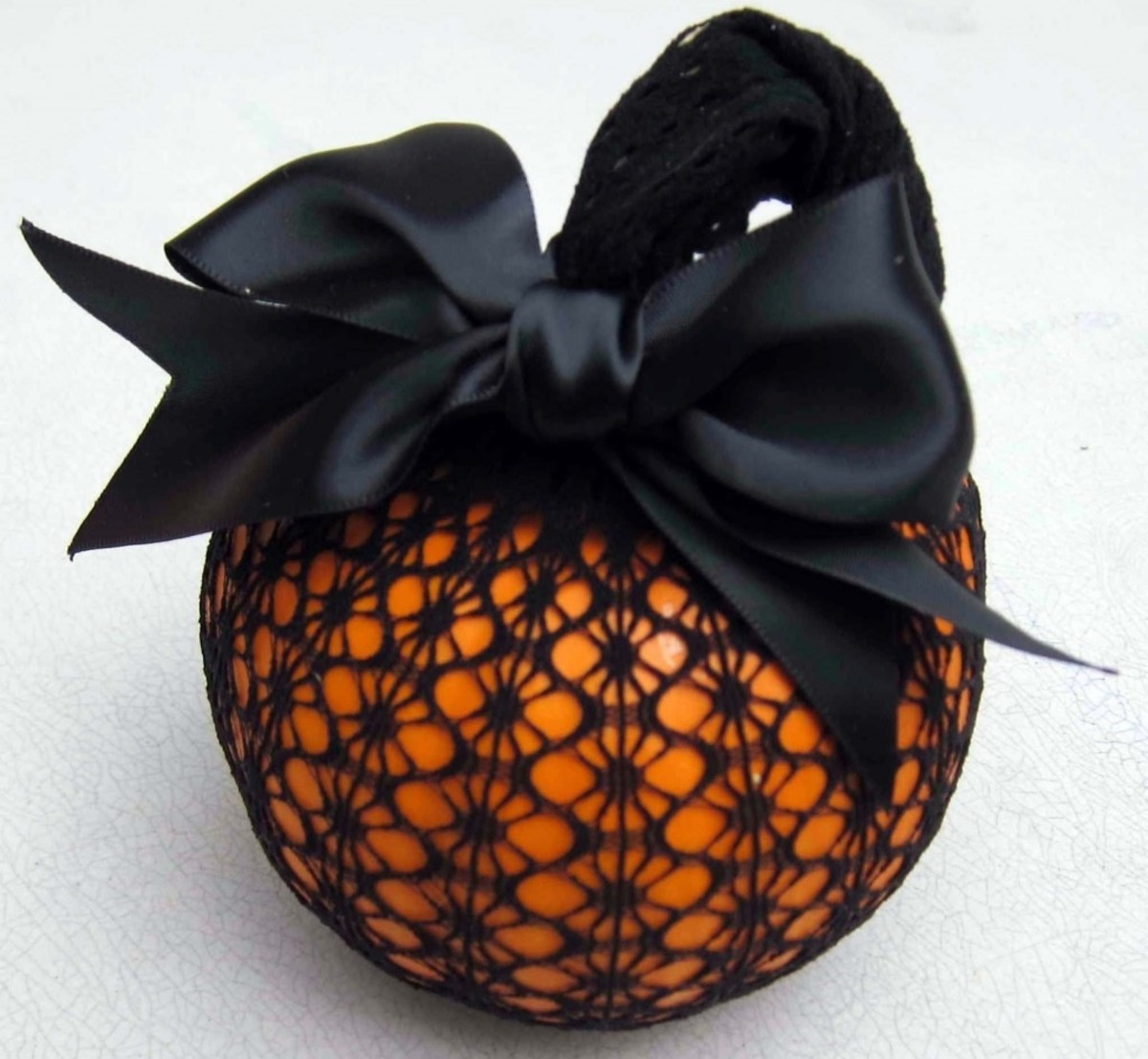 DIY Easy Pumpkin Decorating Ideas Lace Covered Pumpkins with a Bow