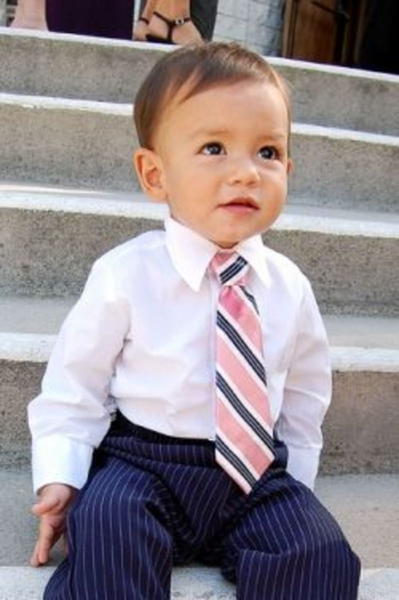"Take a men's tie, disassemble it, and give it new life as a little boy's tie. Perfect for creating a father and son ""twin"" look! I love this project tutorial from Hideous! Dreadful! Stinky! almost as much as I love the name of her blog."