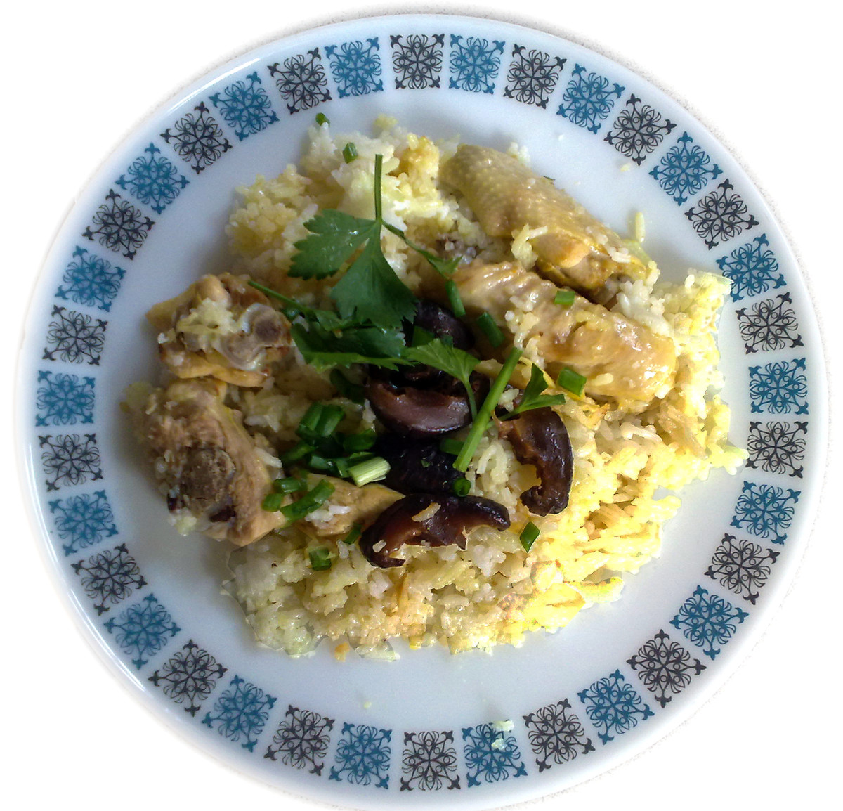 Steamy white rice topped with marinated chicken and Shiitake mushrooms - yummy and wholesome