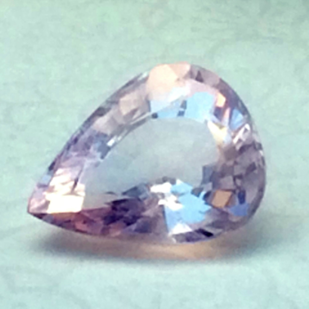 """A large, faceted rose quartz gem displaying the typical """"milky"""" sheen"""
