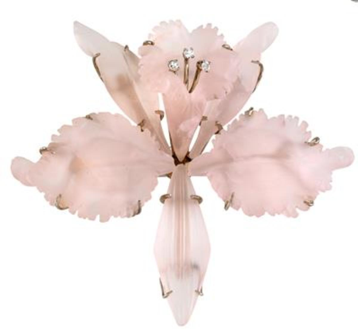 This vintage rose quartz brooch with white gold and 3 octagonal diamonds sold for 1603 Euros at auction.  No, that's not chump change, but imagine what this piece would have cost with some other gemstone! Photo courtesy of Dorotheum.com
