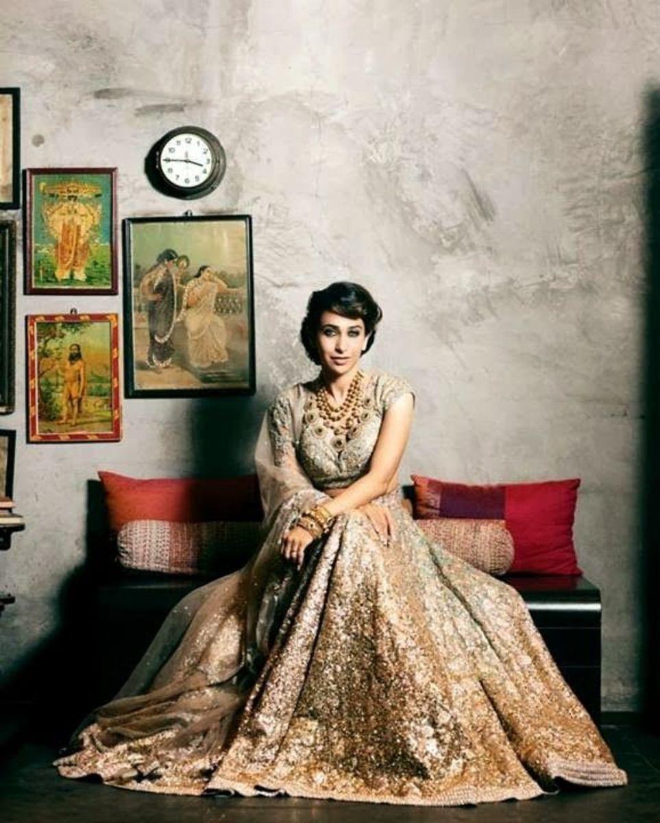 Karishma Kapoor is gorgeous beije Sabyasachi Bridal couture.