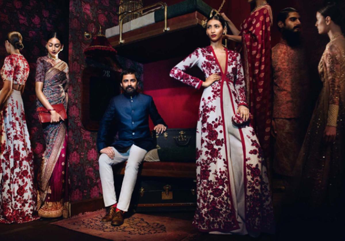 Sabyasachi Mukherjee himself with models wearing his designer clothes