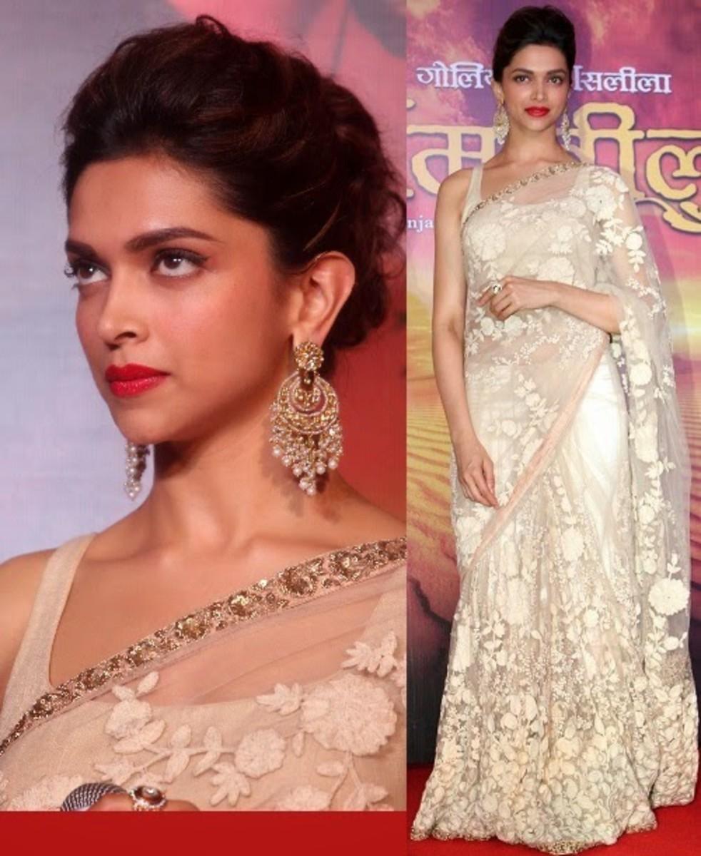Deepika Padukore in Sabyasachi offwhite saree.