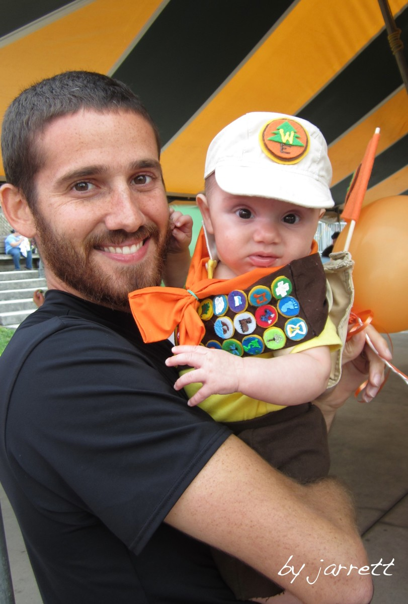 Our little man hanging out with his daddy at the fall festival!