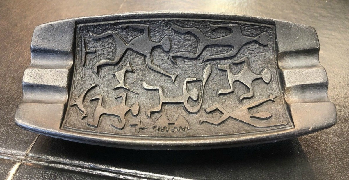 "This is a Coco Joe's mid-century ashtray made in Hawaii from lava. It has Hawaiian dancers and symbols on the front. Ashtray measurments  6 1/2"" long 3"" wide 1 1/4"" tall."