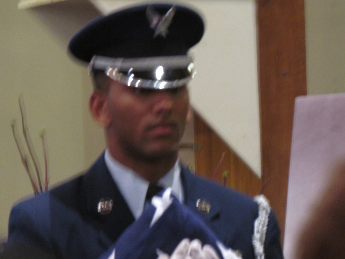 """Taps were performed during the memorial in recognition of """"Blue's"""" military service."""