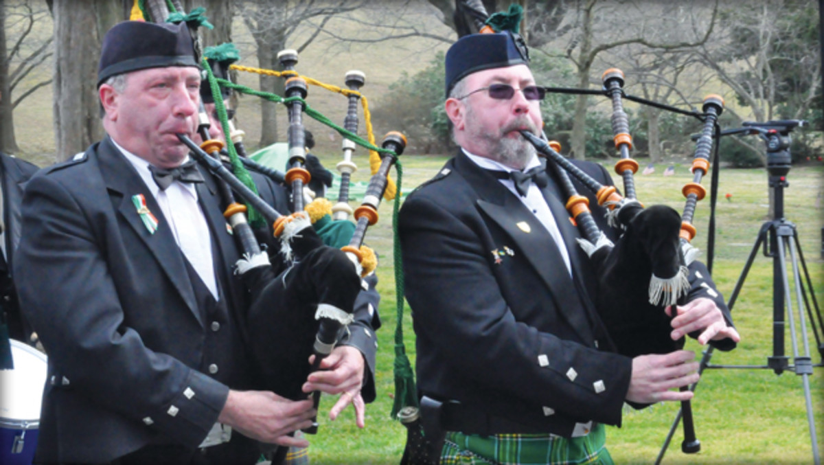 The Watson brothers play the  bagpipes in honor of those who died at Duffy's Cut.